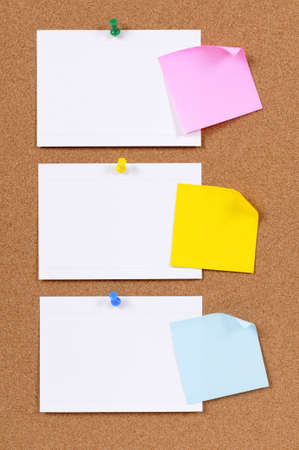 notice board: Index cards and sticky notes on a cork bulletin board.