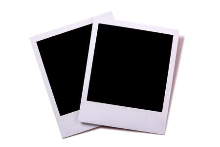 Two blank instant camera photo prints isolated on white with shadow.  Space for copy. Banco de Imagens