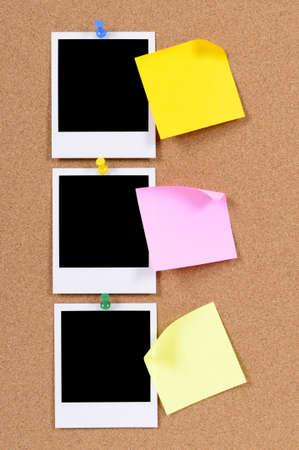 sticky notepaper: Blank photo prints with sticky notes pinned to a cork bulletin board.