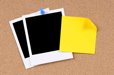 Blank photo prints with sticky note pinned to a cork bulletin board. photo