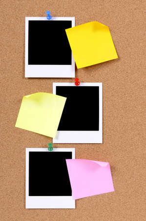 pinned: Blank photo prints with sticky notes pinned to a cork bulletin board.