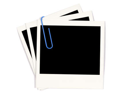 paperclip: Group of instant photo prints with blue paperclip