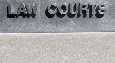 magistrate: Law Courts sign in stainless steel Stock Photo