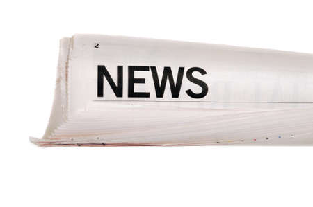 broadsheet: Rolled up newspaper with news headline set against a white background Stock Photo