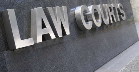 Law Courts sign in stainless steel against black marble