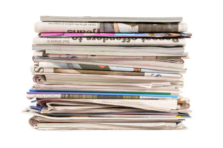newsprint: Pile of old newspapers and magazines against a white background Stock Photo