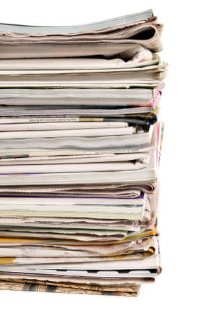 broadsheet: Stack of newspapers and magazines against a white background