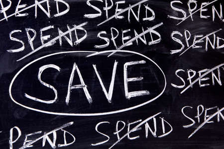 untidy: Untidy spend and save message written on a blackboard. Stock Photo