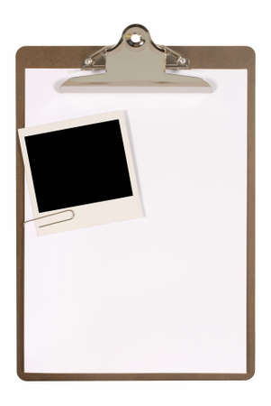 plain paper: Ordinary clipboard with plain paper and an instant camera photo print isolated on a white background.  Space for copy. Stock Photo