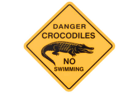 australasia: Australian crocodile road warning sign with no swimming isolated on a white background. Stock Photo