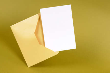 Manila brown envelope with blank letter card stock photo picture metallic gold envelope with blank message card letter or invitation isolated on a green background stopboris Image collections