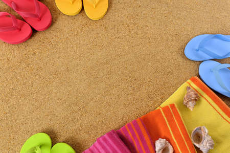 flip flops: Beach background with towel and flip flops.  Space for copy.