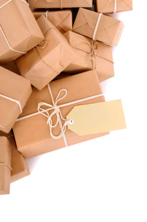Untidy pile of brown parcels with label photo