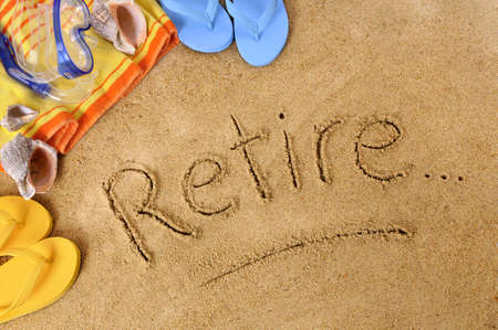 retiring: Beach background with towel and flip flops and the word Retire written in sand.
