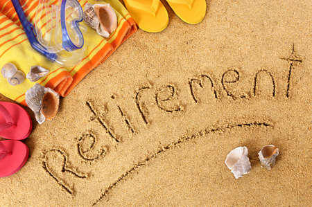 plan a: Beach background with towel and flip flops and the word Retirement written in sand.