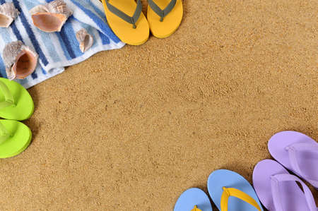 space for copy: Beach background with towel and flip flops.  Space for copy.