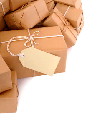 untidy: Untidy pile of brown parcels with label