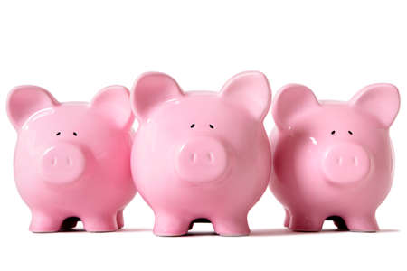 white piggy bank: Row of three pink piggy banks isolated on a white background.  Sharp focus on middle piggy.