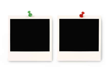 Two blank instant camera photo prints with blue and red pushpins isolated on a white background.  Space for copy.
