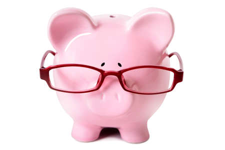 advising: Pink piggy bank wearing glasses isolated on a white background.