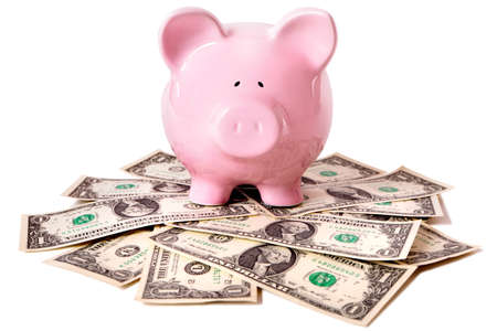 untidy: Pink piggy bank standing on an untidy pile of one dollar bills.  Isolated on white. Stock Photo
