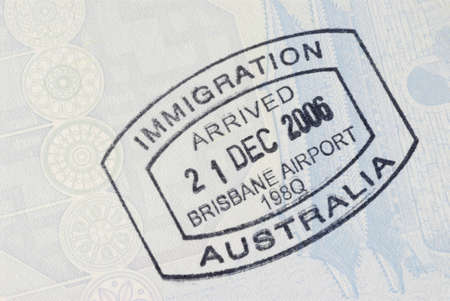 migrate: Australia immigration entry stamp on the inside page of a passport.  Space for copy. Stock Photo