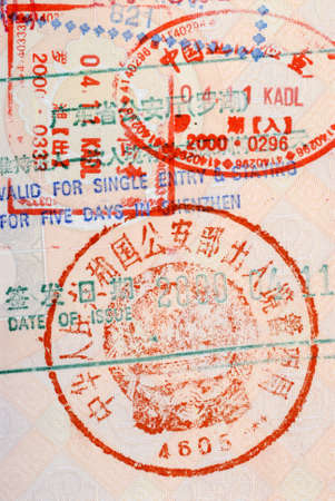 customs official: Chinese customs immigration travel stamp on the inside page of an Asian passport