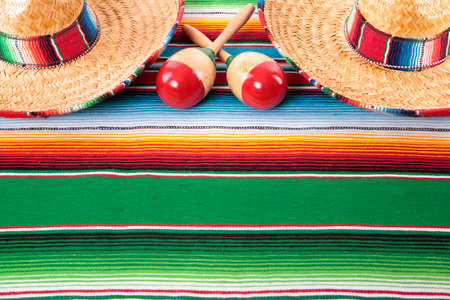 serape: Mexican sombreros and maracas on a traditional serape blanket.  Space for copy.