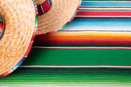 serape: Mexican sombreros and traditional serape blanket.  Space for copy.