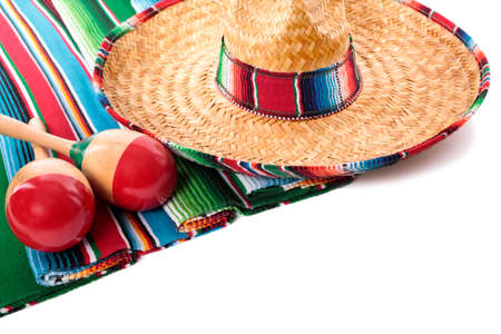 serape: Traditional Mexican serape blanketor rug with sombrero and maracas isolated against a white background.  Space for copy.