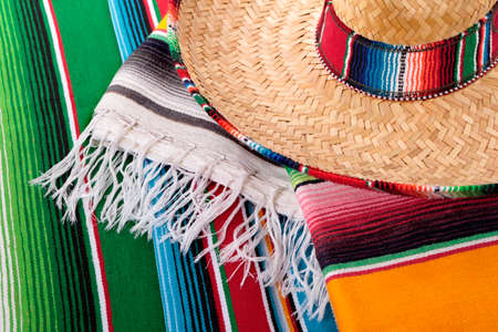 serape: Traditional Mexican serape blankets or rugs with sombrero.