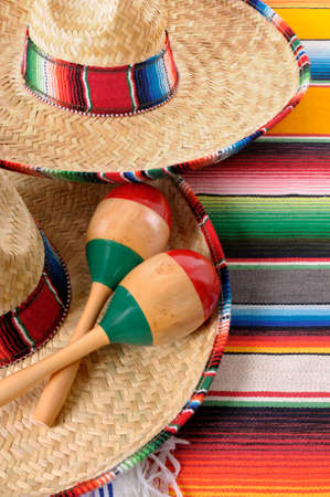 serape: Mexican scene with sombrero straw hat, maracas and traditional serape blanket or rug. Stock Photo