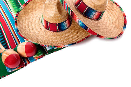 Traditional Mexican serape blanket or rug with sombreros and maracas isolated against a white background.  Space for copy. photo
