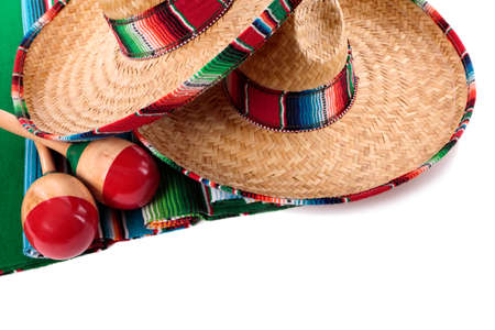 serape: Traditional Mexican serape blanket or rug with sombreros and maracas isolated against a white background.  Space for copy.