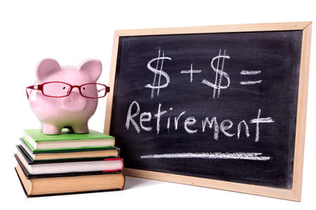 Pink piggy bank with glasses standing on books next to a blackboard with simple retirement formula.  Sharp focus on the piggy bank. photo