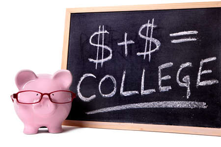 Pink piggy bank with glasses standing next to a blackboard with simple college savings or fees formula. photo