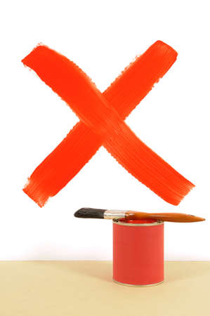 paint can: Red cross or letter X painted on a white wall with paint can and paintbrush.