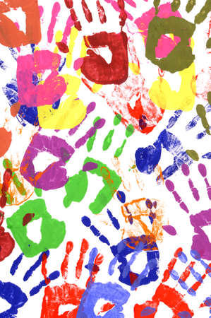 untidy: Messy or untidy pattern of child handprints made from vivid acrylic paint isolated on a white paper background. Stock Photo
