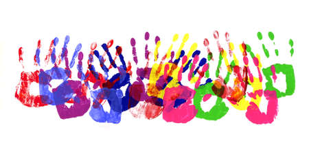 handprints: Horizontal border pattern of child handprints made from vivid acrylic paint isolated on a white paper background.
