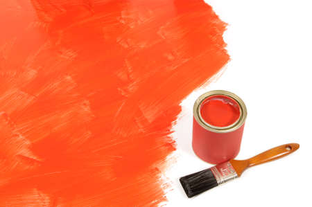 paint can: Partly finished blank red painted floor with paint can and paintbrush.  Space for copy. Stock Photo