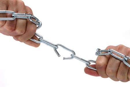 hand chain: Metal chain being forced open by the strength of a man Stock Photo