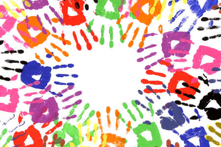 untidy: Untidy circle of child handprints made from vivid acrylic paint on white paper