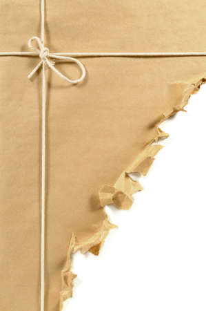 untidy: Brown paper parcel or package tied with string and torn open in an untidy manner isolated on a white background.  Space for copy. Stock Photo