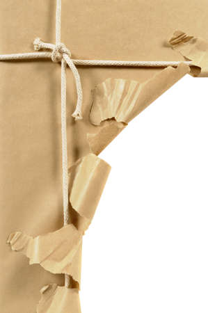 unwrapped: Brown paper parcel or package tied with string and torn open in an untidy manner isolated on a white background.  Space for copy. Stock Photo