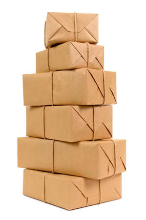 Tall stack of brown paper packages isolated on white. photo