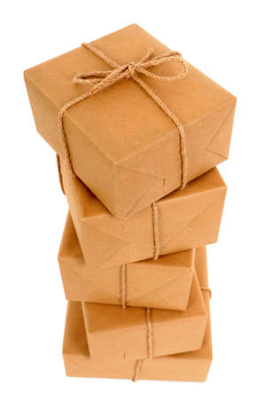 Tall stack of brown paper packages isolated on white photo