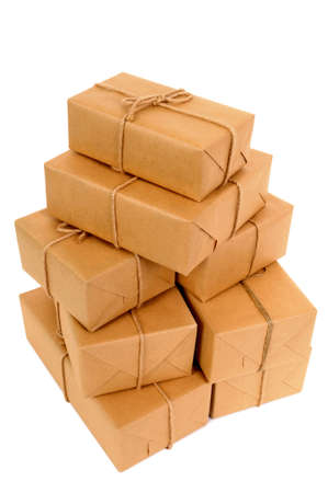 mail order: Untidy stack of brown paper packages isolated on white.