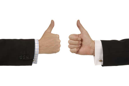 thumbsup: Two businessmen giving thumbs up signs. Stock Photo