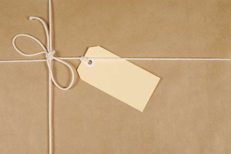 mail order: Brown paper parcel background with string and label