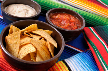 serape: Mexican traditional serape blankets with salsa dip and tortilla chips.